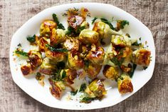 April Bloomfield& Pot-Roasted Artichokes With White Wine Recipe - NYT Cooking Vegetable Sides, Vegetable Recipes, Vegetarian Recipes, Healthy Recipes, Weeknight Recipes, Easy Recipes, Wine Recipes, Cooking Recipes, Cooking Corn