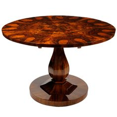 An Elegant Biedermeier Table with Pear-Shaped Base