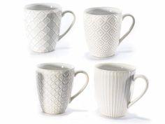 Tazzina in ceramica con decoro in rilievo  Ø 7,4 cm x 8,7 H Capacità: 210 ml