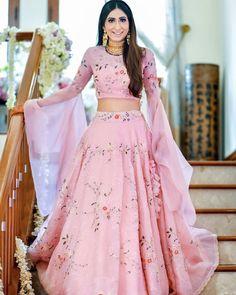 This blush pink outfit is simply a breath of fresh air! Look at those elongated sleeves 😍 Shot by Lehnga Dress, Lehenga Blouse, Lehenga Choli, Bollywood Lehenga, Bollywood Style, Dress Skirt, Blouse Back Neck Designs, Blouse Designs, Indian Bridal Lehenga