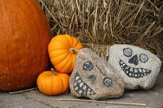 transform rocks into hallowe'en skulls with acrylic paints