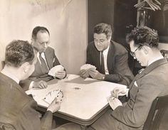 The Four Aces playing five-suited bridge.