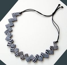 original origami paper necklace with zebra black & white stripes      In my opinion the cloak of zebras is an artwork of nature and so I could not help but
