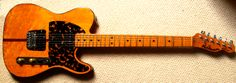 H.S. Anderson Madcat - later sold under the Hohner name as well. Prince's early-career guitar, seen recently as well.