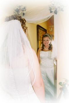 06-17-06 a Bride looking in the mirror, or looking at her bouquet is always unique