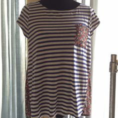Anthropologie Stripe and Floral Top So cute, navy and white stripes on one side and navy and red contrasting floral pattern on back, with matching chest pocket. In very good used condition. Anthropologie Tops