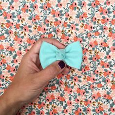 "Budget Bows are a 3"" classic style hair bow with a knotted center. *This listing is for ONE budget bow. This bow is made with a polyester/acrylic felt and permanently attached to a single {or double}"