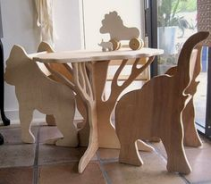 Surround your kid with some animal friends... handmade children's wooden animal chairs and table.