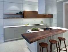 White contemporary kitchen with a live edge counter