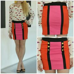 """Valentine's Day skirt!! NWOT Brand new, no tags Get ready to fall in love with this Valentine's Day skirt!!! Features red and pink colors with gold buttons and black trim to add a little edge! Size LARGE 60%polyester 35% rayon 5% Spandex Length Approx:15""""  Slip on style Skirts"""
