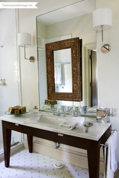 Maybe hang a cool mirror over the one in the back bathroom instead of trying to trim it out?