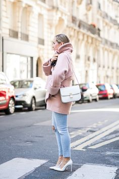 Blogger Brooklyn Blonde wears a light pink coat, distressed skinny jeans, white heels, and a Céline bag