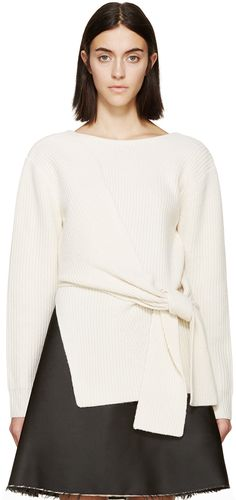 Long sleeve knit sweater in ivory. Ribbed throughout. Boatneck collar. Knotted feature at front panel. Vented at side seams. Plunging collar at back with crossover paneling. Tonal stitching.