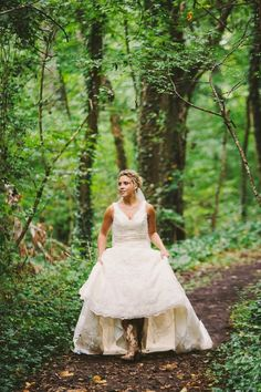 Bride in cowboy boots, in the forest of the Smoky Mountains.   Smoky Mountain Wedding at Dancing Bear Lodge | Bride Link
