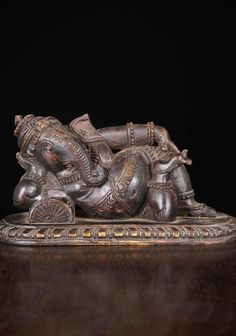 SOLD Dark Wood Reclining Ganesh Statue 11""