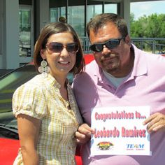Leobardi and Jena with the Oldsmobile Alero they won at TEAM