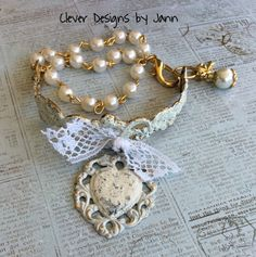 FUF 7/31 .. Almost everything in this bracelet is from B'sue .. heart and bracelet cuff are colored using Ivory Iced Enamel, vintage lace, rosary chain and a couple of dangles on the side complete this sweet Bracelet .. Clever Designs by Jann .. https://www.etsy.com/shop/CleverDesignsbyJann