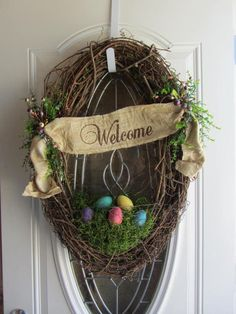 Spring Wreath, Shabby Chic Wreath, Welcome Door Wreath, Easter Wreath, Rustic Wreath Natural oval grapevine door wreath perfect for Spring/Easter Season. Has hand painted wood eggs in assorted bright Easter colors, spanish moss with chicken wire, fabric Welcome sign, & berries Wreath dimensions: 30 inches tall; 23 inches wide; 6.5 inches deep.