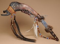 This is a beautiful Native American buffalo jaw bone tomahawk war club. This is an actual Native made tomahawk made by the Creek Indians. This decorative tomahawk is decorated with fur, feathers and h Native American Tools, Native American Decor, Native American Artifacts, Native American Indians, American Indian Art, Bone Tomahawk, Club Weapon, Crane, Bone Crafts