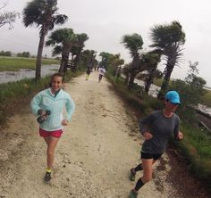 runners on the rails to trails during a stormy morning