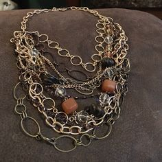 Layered Necklace Lovely layered necklace features crystals and stones, lots of varied style chains. Very eye catching. Dress Barn Jewelry Necklaces