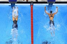 (L-R) Mireia Belmonte Garcia of Spain touches the wall to win gold ahead of Natsumi Hoshi of Japan in the Women's 200m Butterfly Final on Day 5 of the Rio 2016 Olympic Games at the Olympic Aquatics Stadium on August 10, 2016 in Rio de Janeiro, Brazil.