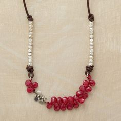 RUBIES AND MORE NECKLACE�--�Naomi Herndon mixes materials to mesmerizing effect: a swarm of faceted rubies, sterling silver beads and paillettes, leather cord. Handcrafted exclusively for us with a hook clasp. Approx. 17L.
