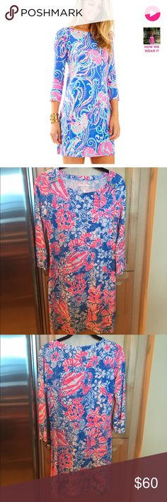 Lilly Pulitzer Sophie Dress in pink and blue XS Lilly Pulitzer Sophie Dress in blue/pink/white. Printed dress with boat neckline and gold button detail. Size XS. EUC. Worn once. No flaws. Please note stock photo has a different print. Approx 35 inches from top of shoulder to hem. Rayon Spandex Jersey. Does not wrinkle. Style #17412. Smoke free home. Lilly Pulitzer Dresses