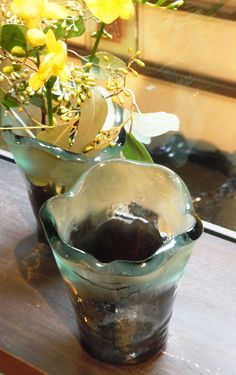 Small glass bud vases for tabletop decoration. By Glass Studio