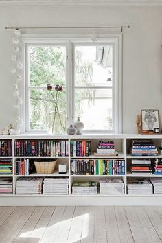 Space Saving Bookshelf Giving Solution for Small Rooms: Taking Benefit Of Window Area To Install Short White Bookcase For And Works Of Art O... White Bookshelves, Bookshelves For Small Spaces, Living Room Bookshelves, Bookshelf Ideas, Book Storage Small Space, Bookshelves Online, Organize Bookshelf, Build In Bookshelves, Small Living Room Storage