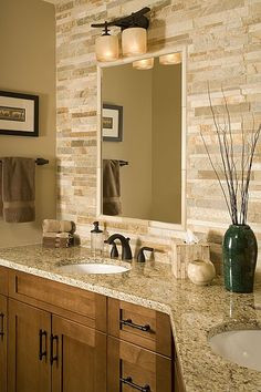 Stone backsplash give this master bathroom a unique crafted flare.