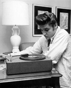 ♡♥Elvis 21 plays a record in 1956 - click on pic to see a larger pic and many more Elvis at age 21 pics♥♡