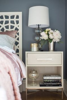 Lovely pink and blue colour palette in this bedroom.  If you like this, come on over and join us at http://www.TheHomeDesignSchool.com. Join up for a whole home decorating resource library.