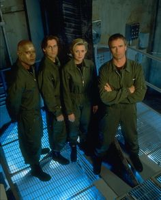 THE OLD TEAM. Back when Jack was young, Teal'c was bald, Daniel has floppy hair and Sam... was adorable. As always.