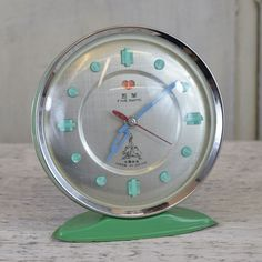 Five Rams Chinese green metal alarm clock with bakelite buttons for the numerals. Vintage Alarm Clocks, Vintage Green, Chinese, Buttons, Metal, Watches, Face, Products, Wristwatches