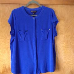 Lovely blouse with contrasting buttons and rivets. Very pretty blouse, cap sleeves, nice feeling material, front buttons, really pretty color....purple/blue, worn only once. Dana Buchman Tops Blouses
