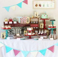 red, aqua, and yellow dessert table decorated with vintage abc cards, wagon, etc.
