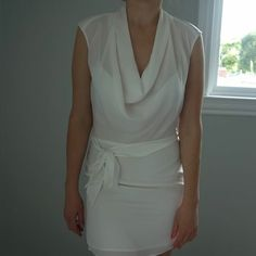 Guess by Marciano dress Very light on shoulder has a leather detail beautiful drape. Belt skirt part fully lined like new worn one time Guess by Marciano Dresses Mini