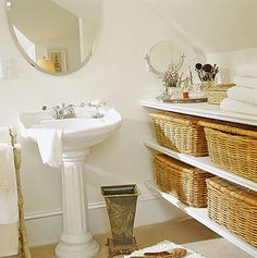 Wicker Basket Storage - idea for our bathroom - build shelves under the window & put pretty baskets there to store 'stuff'