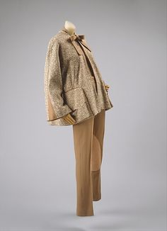 Beige riding-wear-inspired ensemble (wool tweed jacket, wool pants, wool blouse, printed silk handkerchief, leather gloves), by Vera Maxwell, American, 1948.