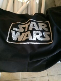 Added vinyl Star Wars logo to linen tablecloth :) First time adding heat transfer vinyl to a linen table cloth!!! Too bad we didn't get a chance to display it so much happening on the day of the party it ended up staying in the box:/