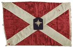 """Manly's Battery flag, 1st N.C. Artillery. The Battery was organized in Raleigh, NC and called the """"ELLIS LIGHT ARTILLERY"""" and """"ELLIS FLYING ARTILLERY"""" in honor of then governor John W. Ellis. When the battery's first captain, Stephen Dodson Rameur was appointed Colonel of the 49th Regiment NC Troops, 1st Lieut. Basil C. Manly was elected captain. The men decided to rename their company """"Manly's Battery"""" in his honor. It was under this name that the battery served for the rest of the war."""