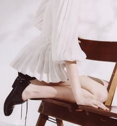 Sheer pleats and patent leather oxfords