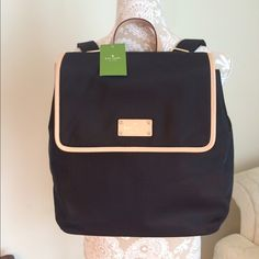 Kate Spade Backpack Black & Cream NWT! Gorgeous backpack from Kate Spade. Style: Neko Kennedy Park. New with tag attached. Material is nylon in black color. Leater trims in cream color. Fully lined in signature KS hot pink material. Adjustable shoulder straps. Golden hardware✨. Interior zippered pocket. Very roomy and chic. No trade kate spade Bags Backpacks