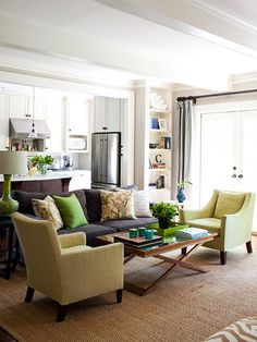Love this living room- neutrals (grey and taupe) with soft pops of color (green, yellow and blue)