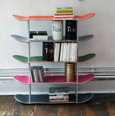 Shelf made by recycled skateboards. @Kelsie Pinckard Pinckard Cagle I thought of you when I saw this! You could totally make it!