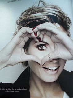 Heart Heidi Klum :) Love the red nail polish and rings