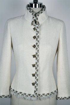 Chanel. Wool tweed. A nice example of a very restrained fabric choice, allowing for more expression with the trim.