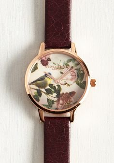 They say that time flies when you're having fun, and with this rose gold Woodland Bird watch by Olivia Burton 'round your wrist, seconds are sure to take flight! Held on your wrist by a burgundy, crazing-detailed leather band and starring a bird and blooms atop its face, this chic timepiece is the precious side of punctuality.