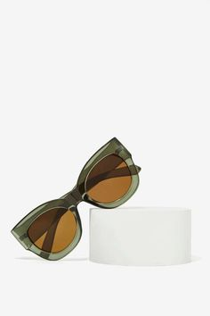 Hide early mornings in these translucent green shades with brown-tinted lenses, UV protection, and an easy slip-on style.